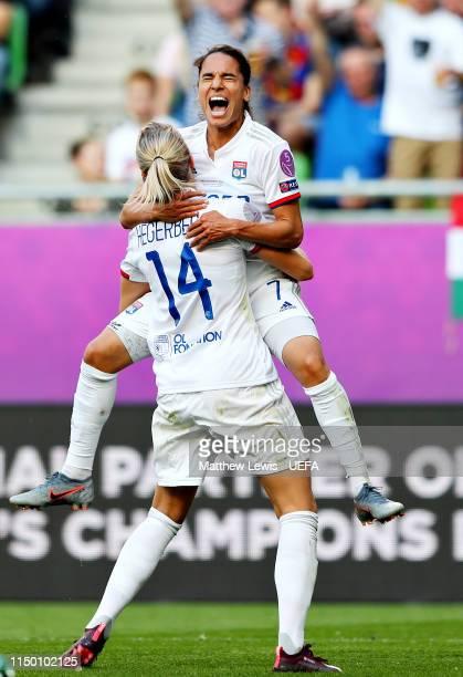 Ada Hegerberg of Olympique Lyonnais Women celebrates scoring her sides third goal during the UEFA Women's Champions League Final between Olympique...