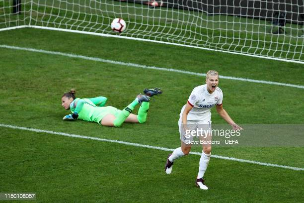 Ada Hegerberg of Olympique Lyonnais Women celebrates scoring her sides second goal during the UEFA Women's Champions League Final between Olympique...