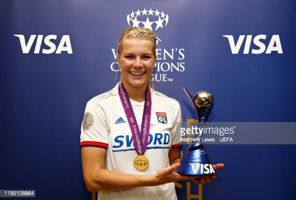 Ada Hegerberg of Olympique Lyonnais Women is presented with the Player of the Match award after the UEFA Women's Champions League Final between...