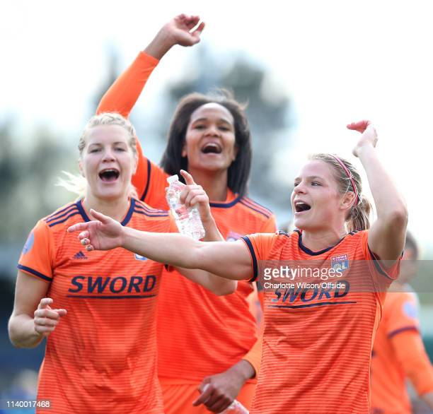 Ada Hergerberg Eugenie Le Sommer and Wendie Renard of Lyon celebrate getting through to the final during the Women UEFA Champions League semi final...