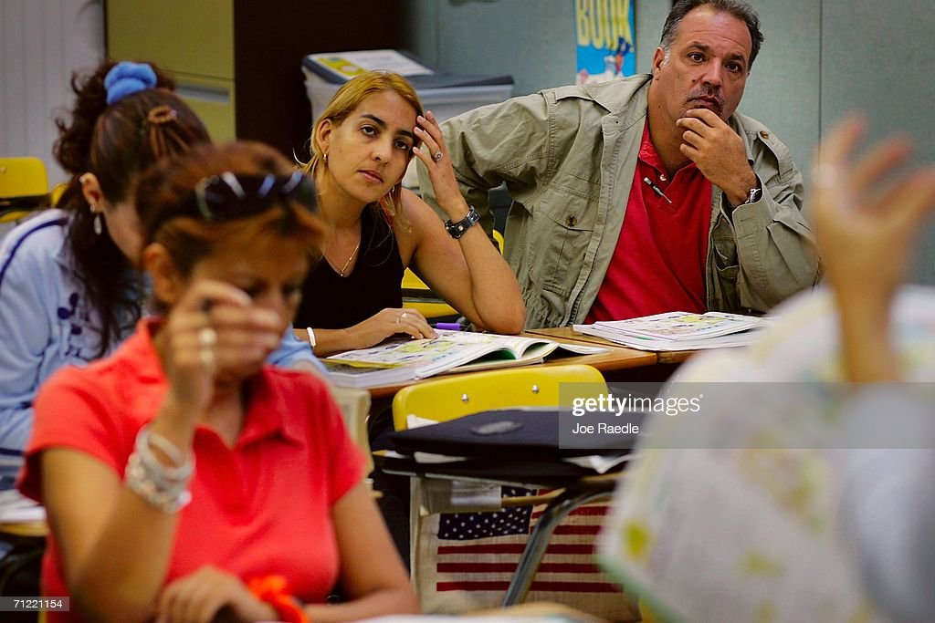 Ada Hernandez (L) from Cuba and Jose Louzao from Argentina listen to their teacher Radka Tomasek as they learn how to speak English at the English Center June 16, 2006 in Miami, Florida. The school holds adult education classes that include English language classes for people who have immigrated to the United States. U.S. President George W. Bush recently said, ?Part of the greatness of America is that we've been able to help assimilate people into our society... And part of that assimilation process is English. I believe this: If you learn English, and you're a hard worker, and you have a dream, you have the capacity from going from picking crops to owning the store, or from sweeping office floors to being an office manager.?