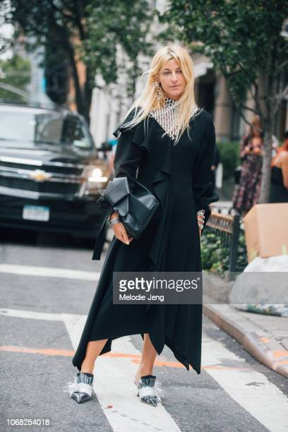 Ada Kokosar in a black dress and black Midnight 00 shoes at the Monse show during New York Fashion Week Spring/Summer 2019 on September 7 2018 in New...