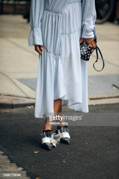 Ada Kokosar in a light blue dress and Midnight 00 shoes after the Jonathan Simkhai show during New York Fashion Week Spring/Summer 2019 on September...