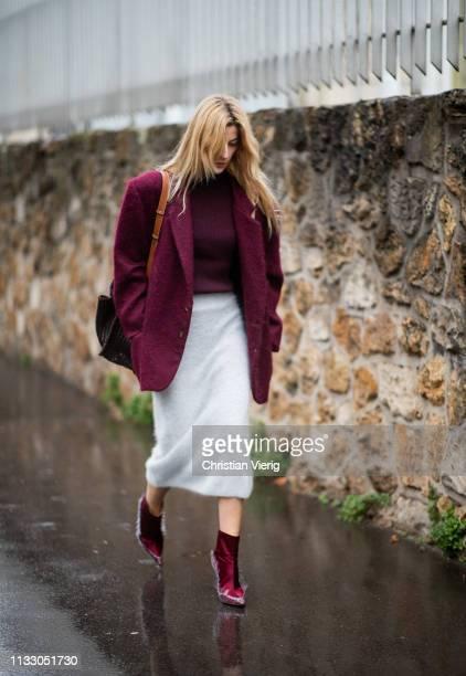 Ada Kokosar is seen wearing bordeaux jacket white skirt outside Loewe during Paris Fashion Week Womenswear Fall/Winter 2019/2020 on March 01 2019 in...