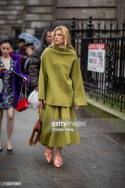 Ada Kokosar is seen wearing green top and skirt bag with fringes heels outside Erdem during London Fashion Week February 2019 on February 18 2019 in...