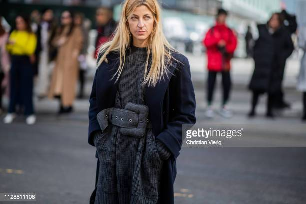 Ada Kokosar is seen wearing grey knit with belt outside Tory Burch during New York Fashion Week Autumn Winter 2019 on February 10 2019 in New York...