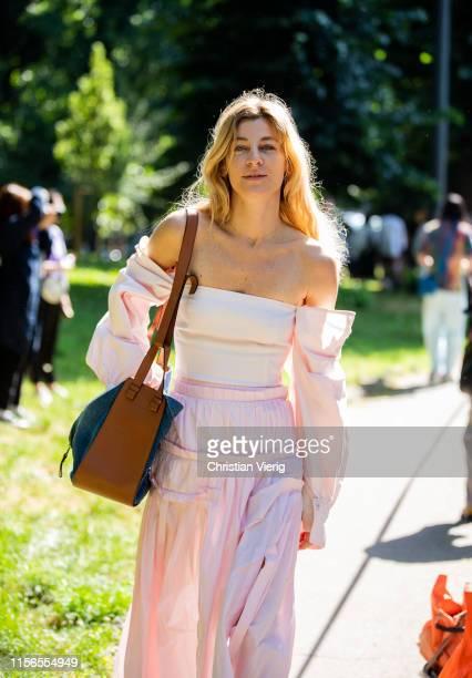 Ada Kokosar is seen wearing pink off shoulder dress outside Fendi during the Milan Men's Fashion Week Spring/Summer 2020 on June 17 2019 in Milan...