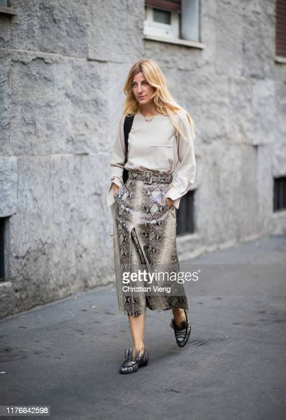 Ada Kokosar is seen wearing skirt with snake print outside the Missoni show during Milan Fashion Week Spring/Summer 2020 on September 21, 2019 in...