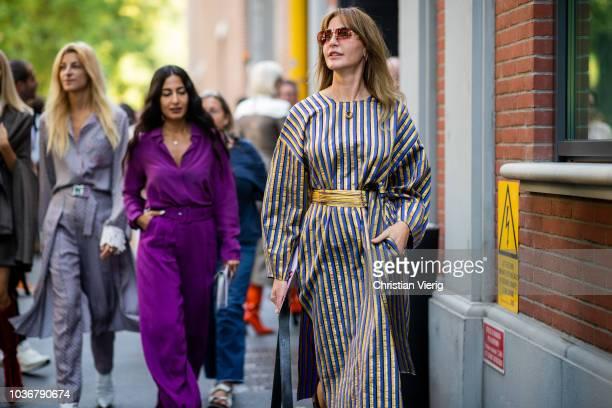 Ada Kokosar Nausheen Shah Ece Sukan seen outside Fendi during Milan Fashion Week Spring/Summer 2019 on September 20 2018 in Milan Italy
