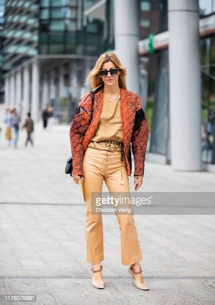 Ada Kokosar seen wearing beige pants top orange quilted jacket outside the Sportmax show during Milan Fashion Week Spring/Summer 2020 on September 20...
