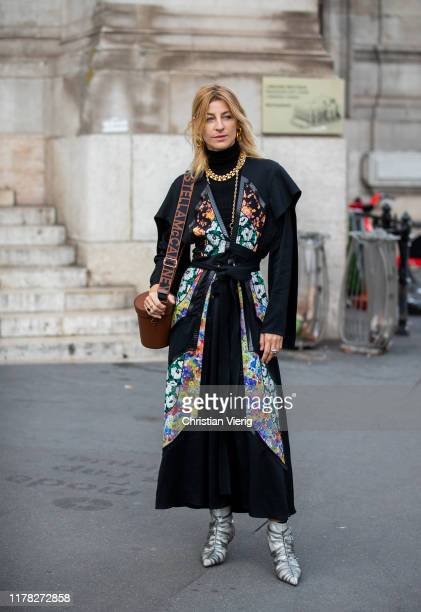 Ada Kokosar seen wearing black belted coat with floral print, bag outside Stella McCartney during Paris Fashion Week Womenswear Spring Summer 2020 on...
