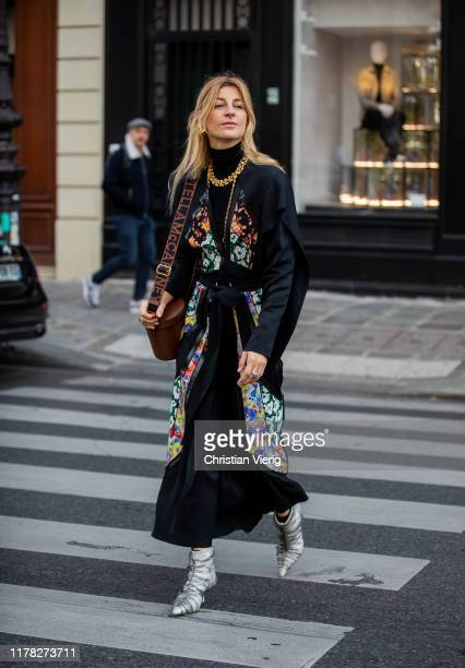 Ada Kokosar seen wearing black belted coat with floral print, bag outside Stella McCartney during Paris Fashion Week Womenswear Spring Summer 2020 on...