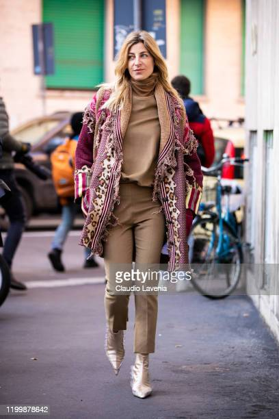 Ada Kokosar, wearing a beige turtleneck sweater, beige pants, gold heels and decorated long cardigan, is seen outside the Etro show during the Milan...