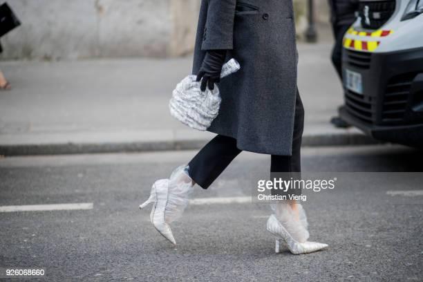 Ada Kokosar wearing bag grey coat heels is seen outside Rochas on February 28 2018 in Paris France