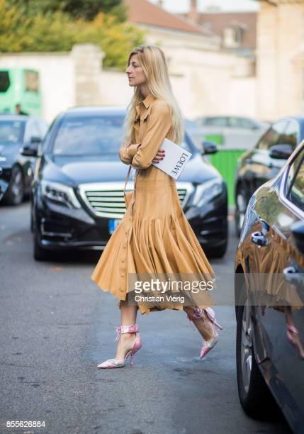 Ada Kokosar wearing beige dress is seen outside Loewe during Paris Fashion Week Spring/Summer 2018 on September 29 2017 in Paris France