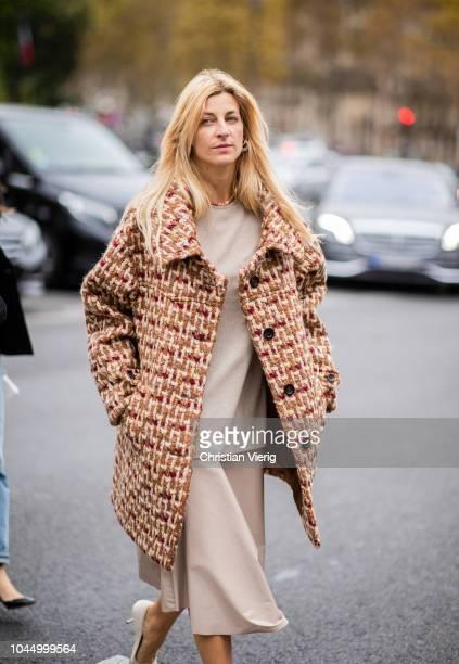 Ada Kokosar wearing beige tweed coat is seen outside Miu Miu during Paris Fashion Week Womenswear Spring/Summer 2019 on October 2 2018 in Paris France