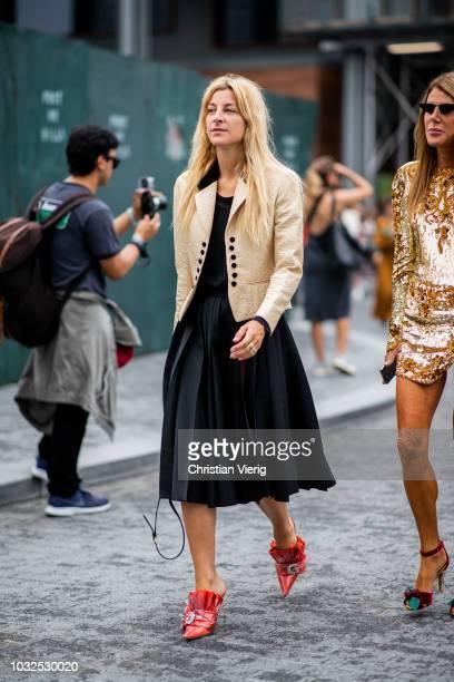 Ada Kokosar wearing black dress gold yellow jacket is seen outside Michael Kors during New York Fashion Week Spring/Summer 2019 on September 12 2018...