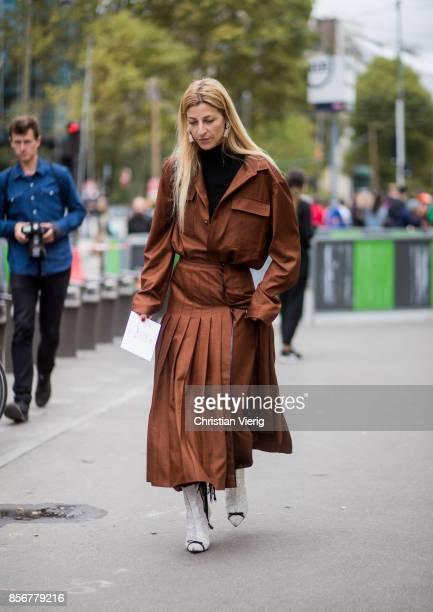 Ada Kokosar wearing brown coat seen outside Giambattista Valli during Paris Fashion Week Spring/Summer 2018 on October 2 2017 in Paris France