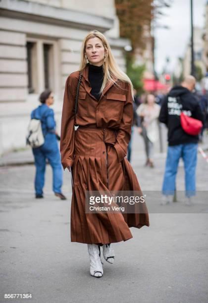 Ada Kokosar wearing brown coat seen outside Sacai during Paris Fashion Week Spring/Summer 2018 on October 2 2017 in Paris France