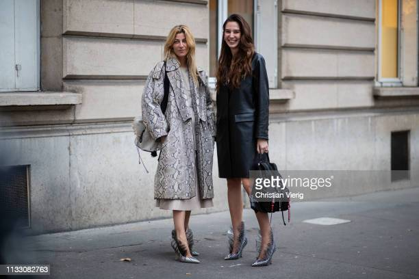 Ada Kokosar wearing coat with snake print and Estelle Pigault is seen during Paris Fashion Week Womenswear Fall/Winter 2019/2020 on March 01 2019 in...