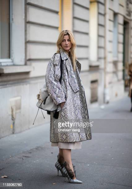Ada Kokosar wearing coat with snake print seen during Paris Fashion Week Womenswear Fall/Winter 2019/2020 on March 01 2019 in Paris France