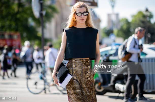 Ada Kokosar wearing cropped top midi skirt is seen outside Chanel on day three during Paris Fashion Week Haute Couture FW18 on July 2 2018 in Paris...