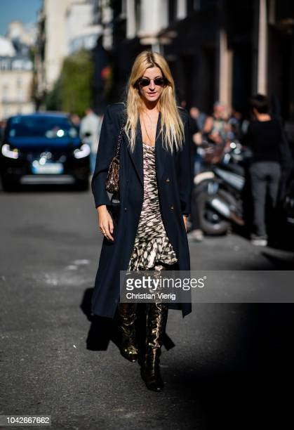 Ada Kokosar wearing navy coat boots dress is seen outside Redemption during Paris Fashion Week Womenswear Spring/Summer 2019 on September 27 2018 in...