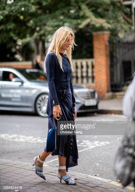 Ada Kokosar wearing navy dress navy bag heels is seen outside Preen during London Fashion Week September 2018 on September 16 2018 in London England