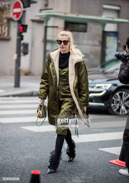 Ada Kokosar wearing olive shearling parka is seen outside Carven on March 1, 2018 in Paris, France.