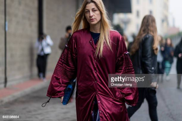 Ada Kokosar wearing red coat outside Diesel during Milan Fashion Week Fall/Winter 2017/18 on February 24 2017 in Milan Italy