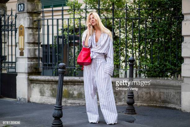 Ada Kokosar wearing striped overall red bag is seen outside Stella McCartney during Milan Men's Fashion Week Spring/Summer 2019 on June 18 2018 in...