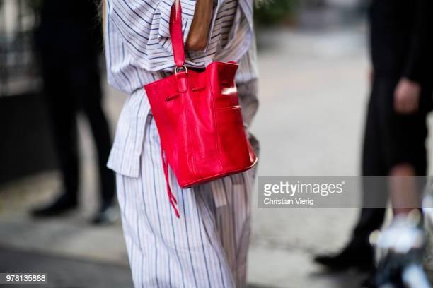 Ada Kokosar wearing striped overall red bag is seen outside Stella McCartney during Milan Men's Fashion Week Spring/Summer 2019 on June 18 2018 in...