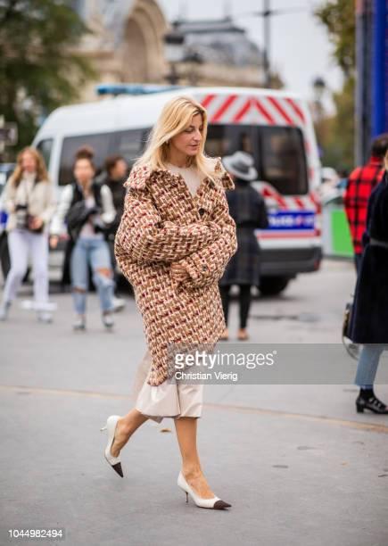 Ada Kokosar wearing tweed coat is seen outside Chanel during Paris Fashion Week Womenswear Spring/Summer 2019 on October 2 2018 in Paris France