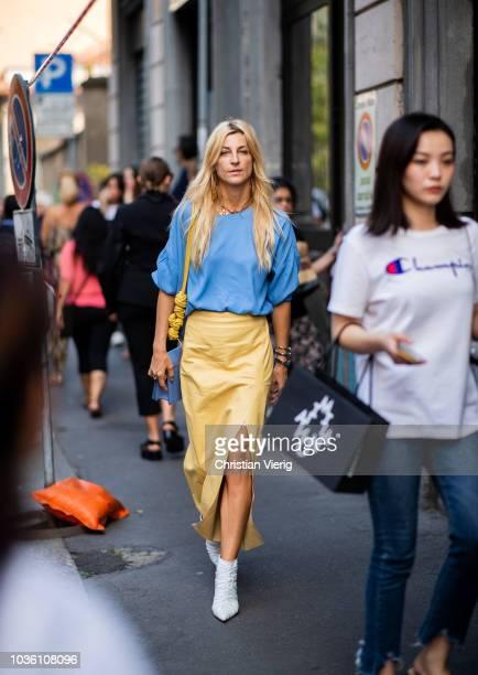 Ada Kokosar wearing yellow skirt with slit blue tshirt is seen outside Jil Sander during Milan Fashion Week Spring/Summer 2019 on September 19 2018...