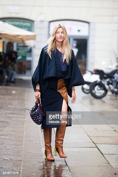 Ada Kokosar wears a navy and brown suede Chadwick Bell assymetrical skirt at Missoni during the Milan Men's Fashion Week Spring/Summer 2017 on June...