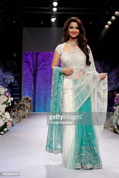 Adaa Khan walks the runway at the Beti show during Day 1 of the India International Jewellery Week at the Grand Hyatt on August 3 2015 in Mumbai India