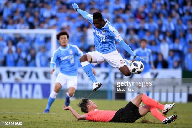 Adailton of Jubilo Iwata and Akira Ibayashi of Tokyo Verdy compete for the ball during the JLeague J1/J2 playoff final between Jubilo Iwata and Tokyo...