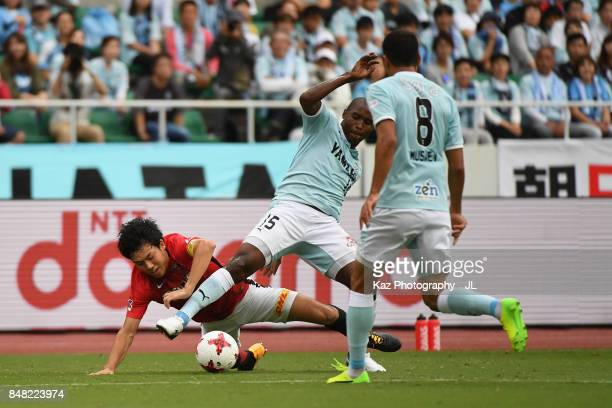 Adailton of Jubilo Iwata and Wataru Endo of Urawa Red Diamonds compete for the ball during the JLeague J1 match between Jubilo Iwata and Urawa Red...