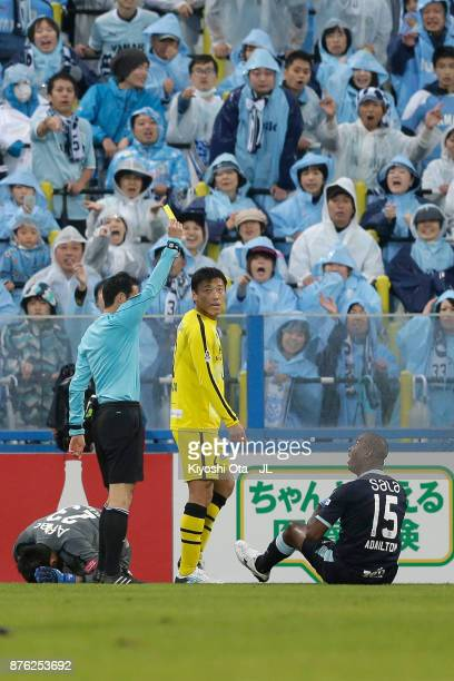 Adailton of Jubilo Iwata is shown a yellow card by referee Hiroyuki Kimura during the JLeague J1 match between Kashiwa Reysol and Jubilo Iwata at...