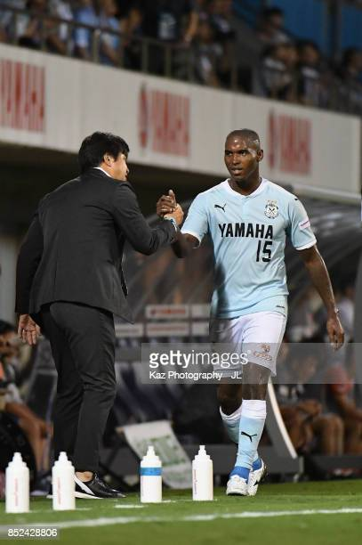 Adailton of Jubilo Iwata shakes hands with head coach Hiroshi Nanami after substituted during the JLeague J1 match between Jubilo Iwata and Omiya...