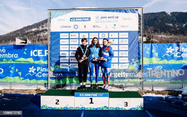 Adake Er Ahena of China Linda Rossi of Italy and Veronika Suslova of Russia celebrate in the NeoSenior Ladies 3000m sprint race during the ISU Junior...