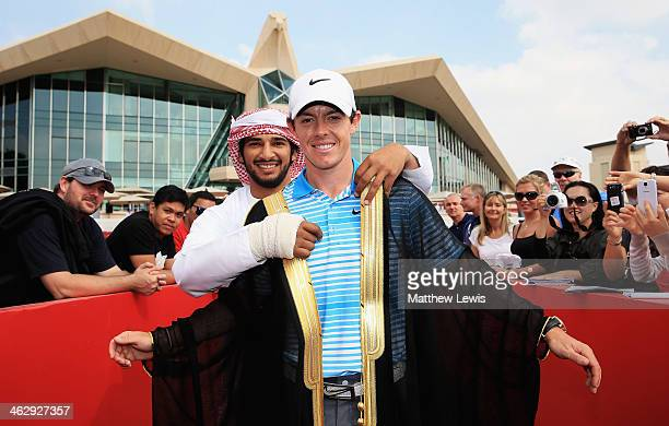 Adal Khalid of Abu Dhabi Ocean Racing presents Rory McIlroy of Northern Ireland with a traditional Emirate 'Bisht' which is a gown given as a gift to...