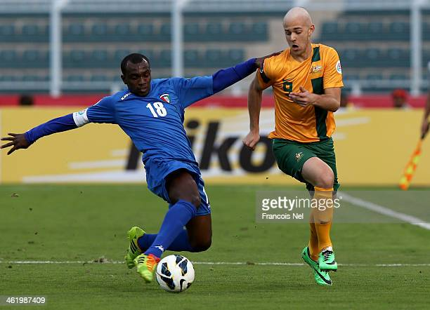 Adal Matar of Kuwait compete for the ball with Dylan Tombides of Australia during the AFC U22 Championship Group C match between Australia and Kuwait...