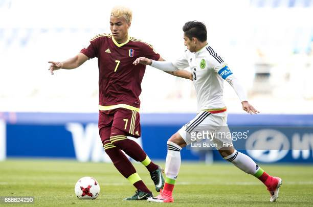 Adalbert Penaranda of Venezuela is challenged by Alan Cervantes of Mexico during the FIFA U20 World Cup Korea Republic 2017 group B match between...
