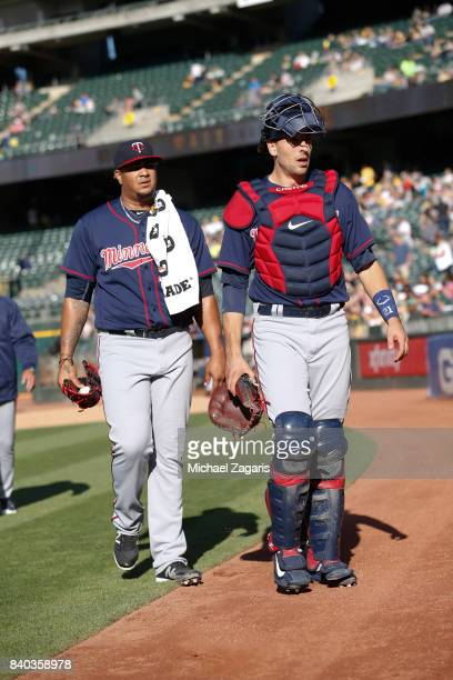 Adalberto Mejia and Jason Castro of the Minnesota Twins stand on the field prior to the game against the Oakland Athletics at the Oakland Alameda...