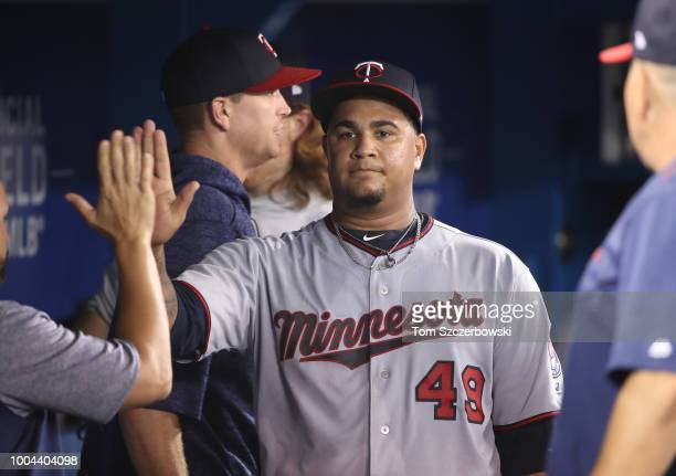 Adalberto Mejia of the Minnesota Twins is congratulated by teammates in the dugout after exiting the game in the sixth inning during MLB game action...