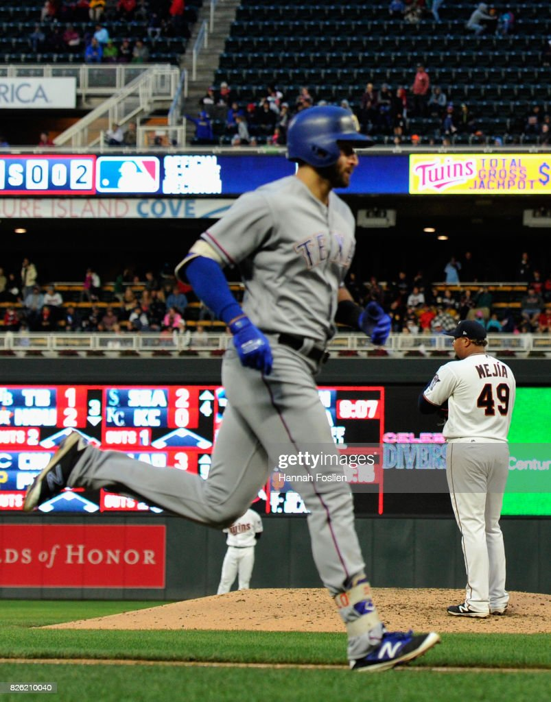Adalberto Mejia #49 of the Minnesota Twins looks on as Joey Gallo #13 of the Texas Rangers rounds the bases after hitting a three-run home run during the fourth inning of the game on August 3, 2017 at Target Field in Minneapolis, Minnesota. The Rangers defeated the Twins 4-1.