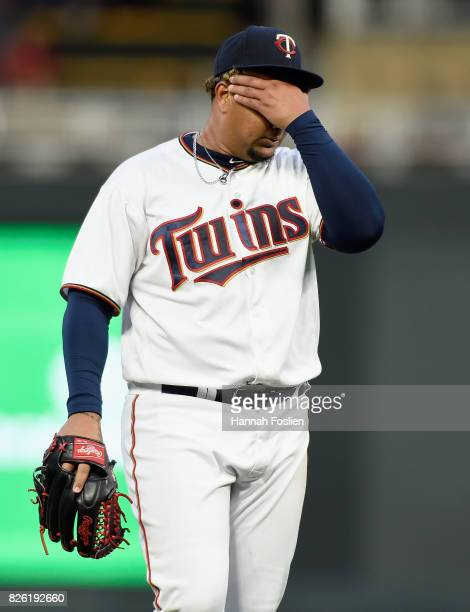 Adalberto Mejia of the Minnesota Twins reacts to giving up a threerun home run to Joey Gallo of the Texas Rangers during the fourth inning of the...