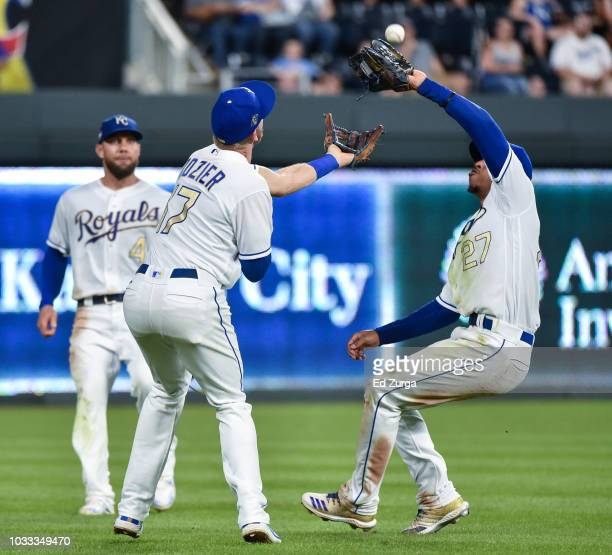 Adalberto Mondesi of the Kansas City Royals avoids colliding with Hunter Dozier as he catches a ball hit by Max Kepler of the Minnesota Twins in the...