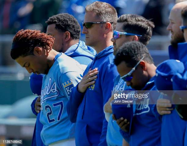 Adalberto Mondesi of the Kansas City Royals bows his head with teammates during the playing of the National Anthem before the game against the...